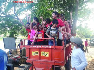 Kids having a thrilling tractor ride